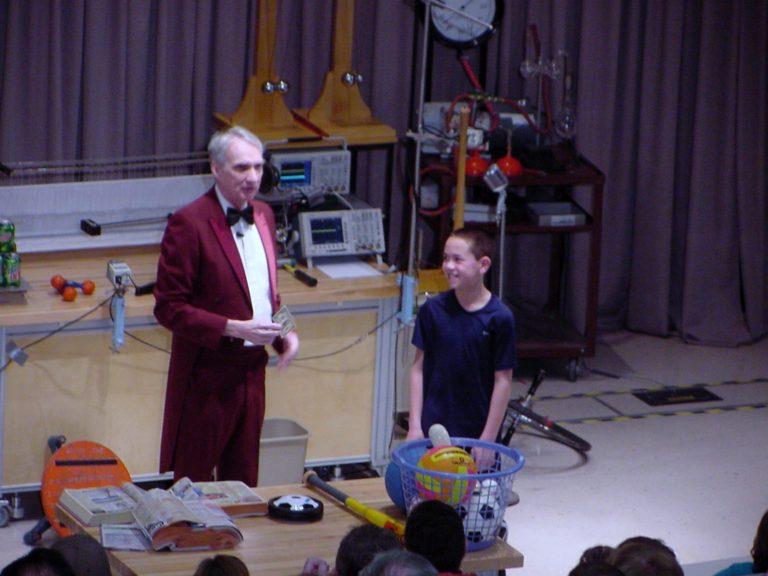 Man talking to boy on stage