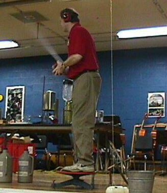 Man showing demonstrating a rocket