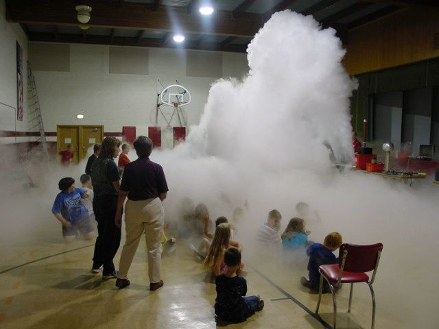 Students watching a cloud being made.