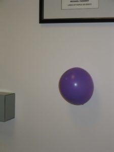 Balloon stuck to wall