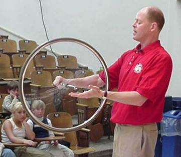 Man spinning a bicycle wheel